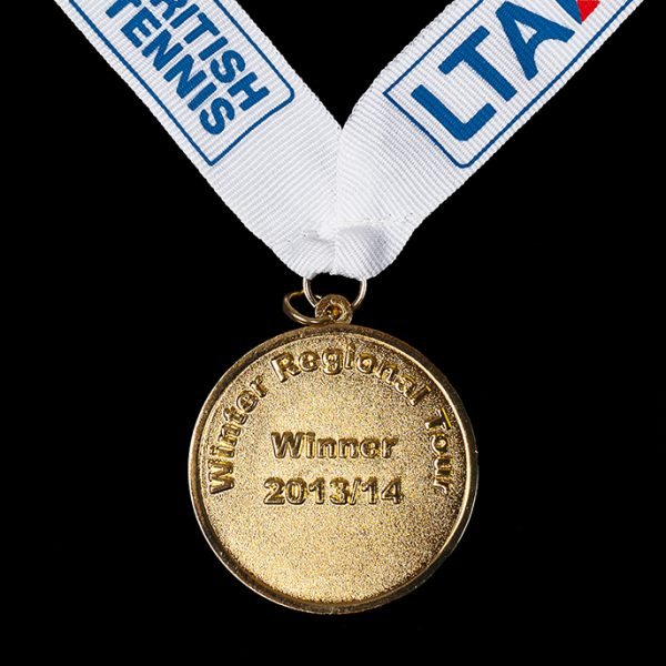 Back of LTA British Junior National Championships Sports Medals - 50mm gold minted Ariel British Juniors National Championships bespoke Sports Medal with blue white ribbon