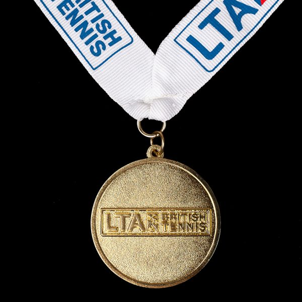 Front of LTA British Junior National Championships Sports Medals - 50mm gold minted Ariel British Juniors National Championships bespoke Sports Medal with blue white ribbon