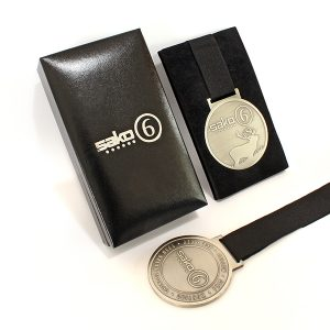 Sako 6 Commemorative Medal features a black ribbon and is displayed in a presentation case