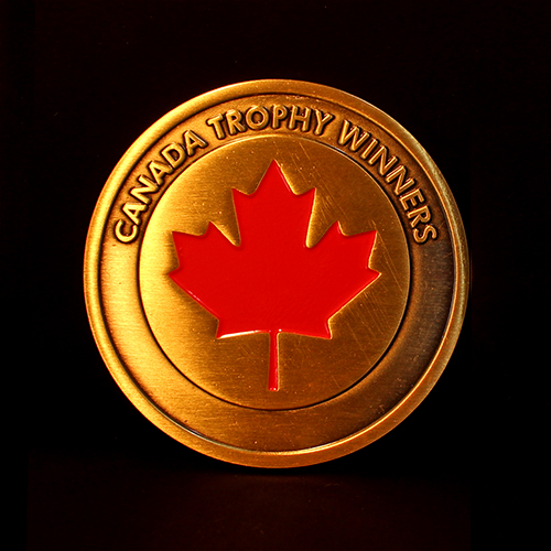 The gold antique Sea Cadet Corps Commemorative Coin for Canada Trophy Winners