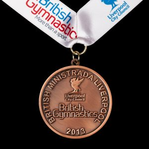 Custom made British Gymnastics medal - British Ministrada Liverpool 2013 - 50mm bronze antique sports medal with a white printed ribbon - Medals UK
