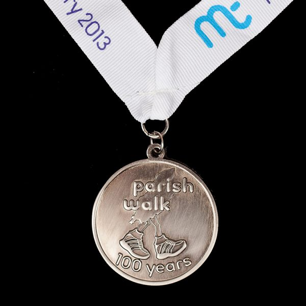 Manx Parish Walk 2013 medals sponsored by Manx Telecom. 50mm gold antique finished sports medal - 100 Years 2013 reverse with a white ribbon and print