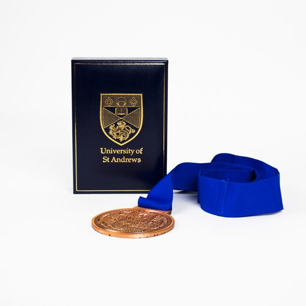 The St Andrews 600 85mm Bronze Antique Sports Medal Reverse with blue ribbon and a gold foil embossed presentation case