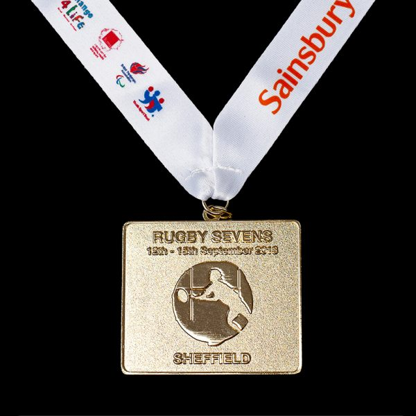 Sainsburys School Games 2013 Finals 50mm Bronze Frosted Polished Rectangle Sports Medal for Badminton with a white ribbon and coloured printed text and logos