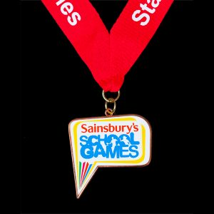 Sainsburys Staffordshire School Games Sports Medal with red ribbon and white print - by Medals UK