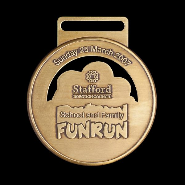 Stafford Fun Run Sports Medal - 50mm gold antique sports medal custom made for the 2007 event by Medals UK