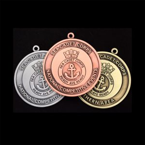 The antique gold silver and bronze Sea Cadet Corp National Competitive Events Awards Medals