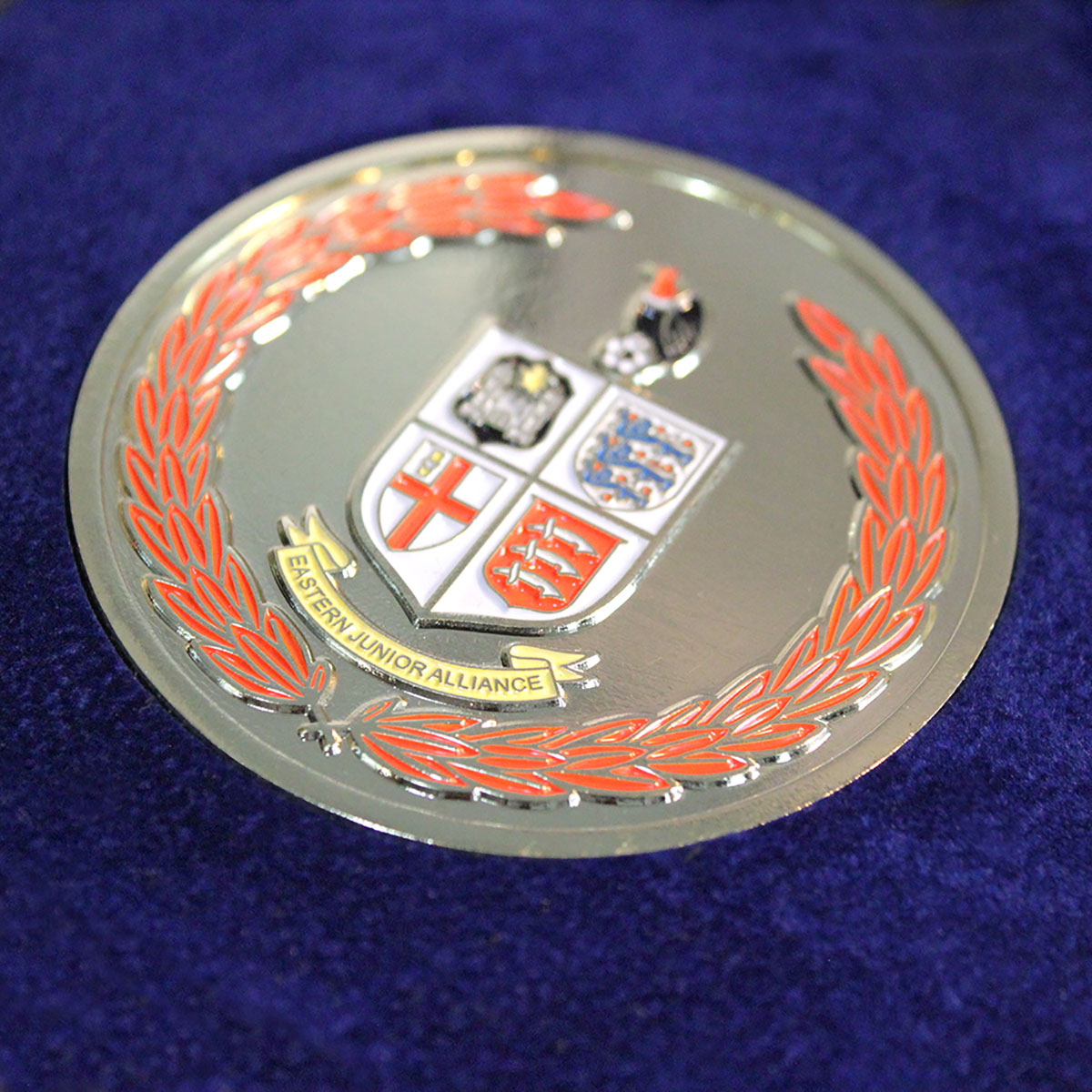 The silver enamelled Eastern Junior Alliance Football League Commemorative Medal produced by Medals UK