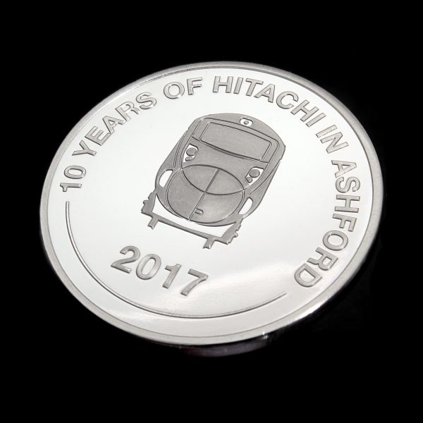 Close up of obverse of Hitachi Rail Europe coin