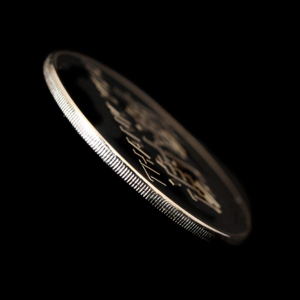 Close up of the milled edge of the AVCC Commemorative Coin for the IVCC