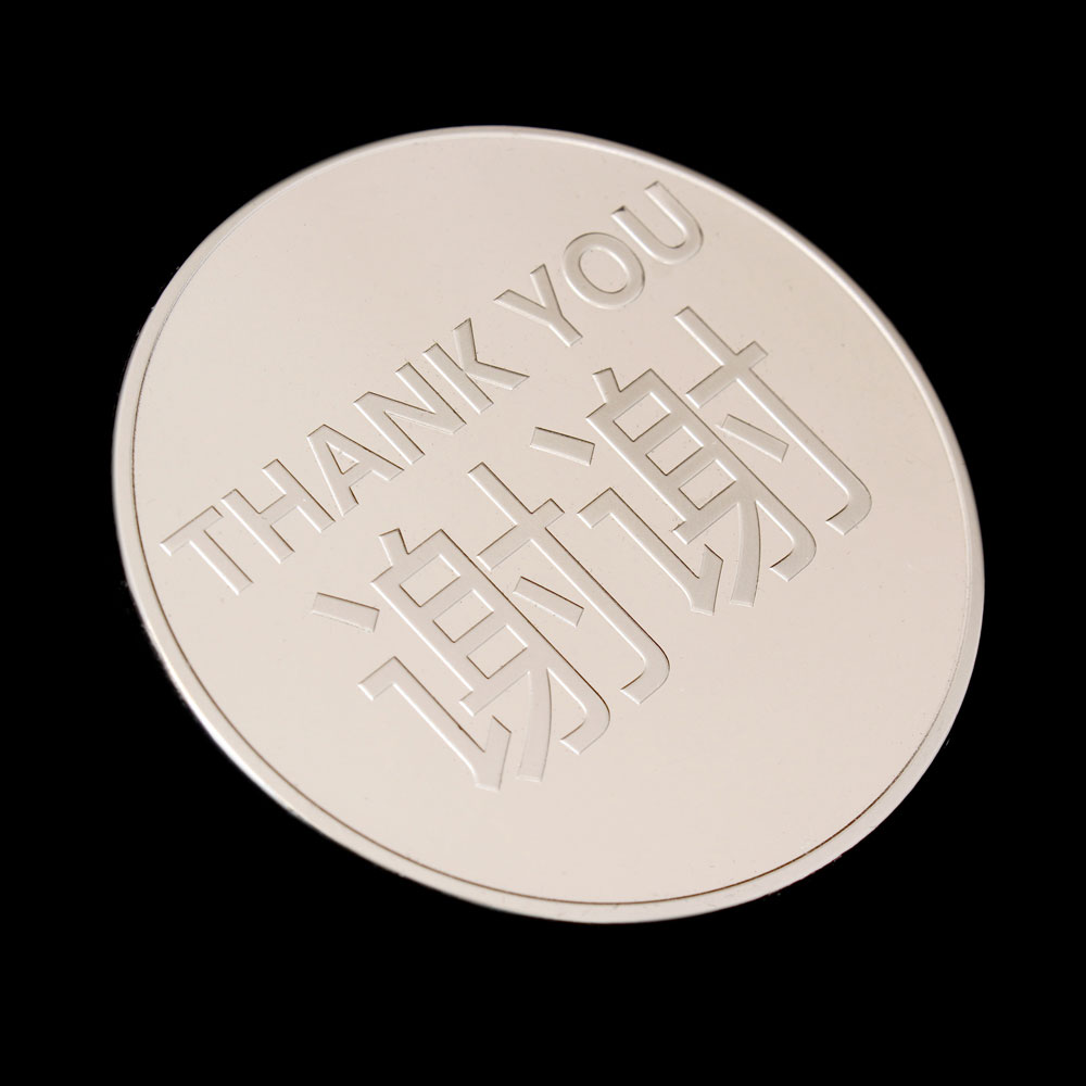 Reverse of AVCC Commemorative Coin for the IVCC with the words thank you in English and Chinese