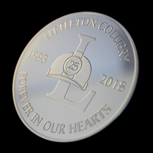 Close up of the obverse of the Littleton Colliery 25 year commemorative coin