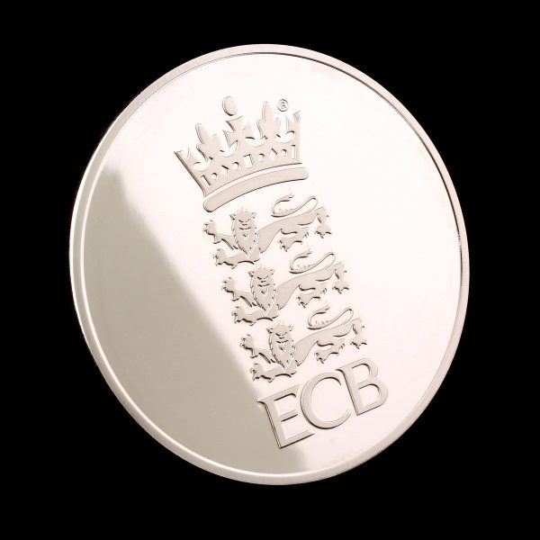 England and Wales Cricket Board Commemorative Coins on black background reflection