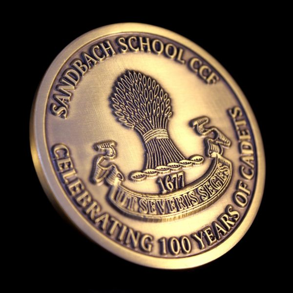 Close up of reverse of Sandbach School Cadets Medal on black background