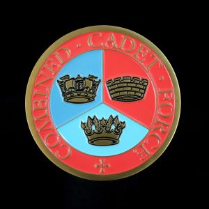 Close up of obverse of Sandbach School Cadets Medal on black background