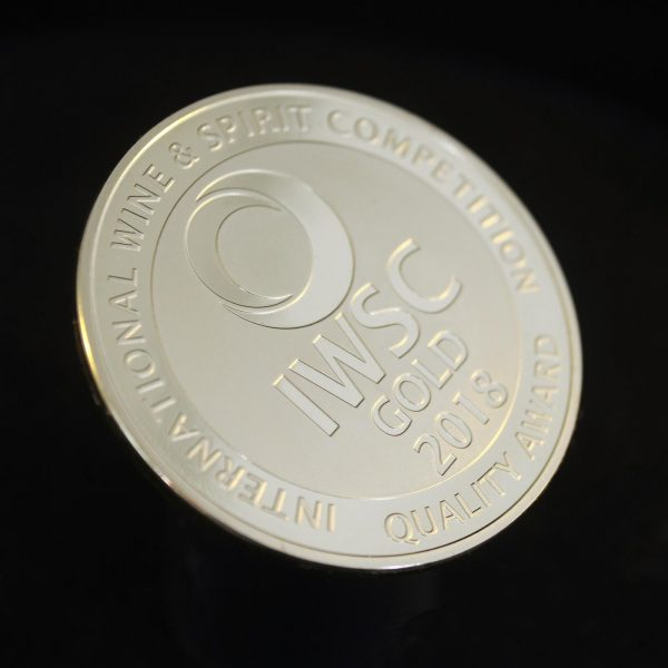 50mm Gold Semi-Proof Medal IWSC Gold quality award 2018 for The International Wine & Spirit Competition on black background