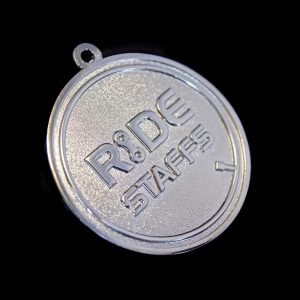 Close up of Ride Staffs Sports Pendant for Leadout Cycling Ltd on black background