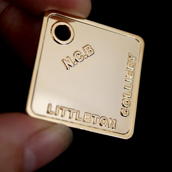 Close up of 32mm Gold Polished Mining Token 32x32 Sq NCB Littleton Colliery for Littleton Colliery Shaft Marker Group