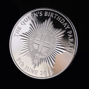 Close up of the Queens Birthday Parade Commemorative Coin