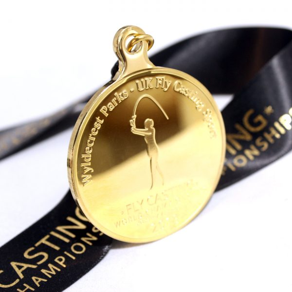 Close up of Gold Fly Casting World Championships 2018 Sports Pendant with ribbon